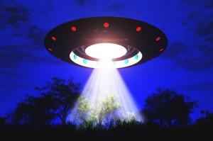 Крыглый НЛО с притягивающим лучом
